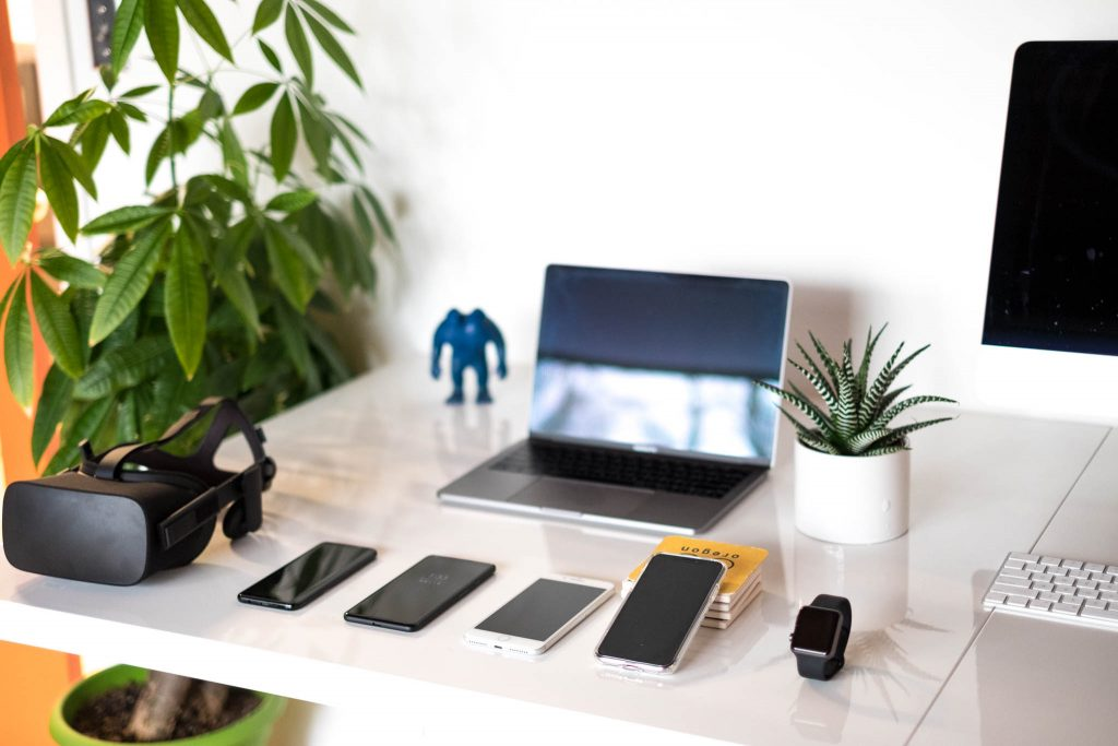 Image of a laptop, virtual reality headset, smart watch, iMac and assorted mobile devices used for testing
