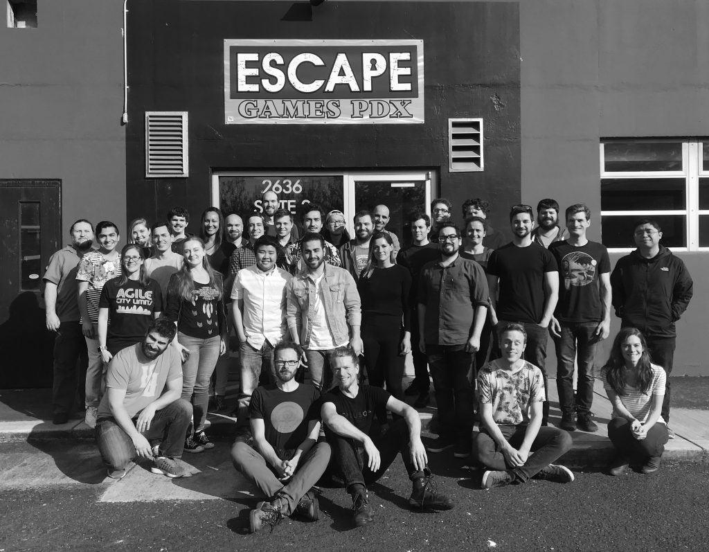 Group photo of employees from PLUS QA in front of Escape Games PDX