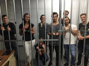 Photo of PLUS QA employees in Prison Break room at Escape Games PDX for PLUS QA Party