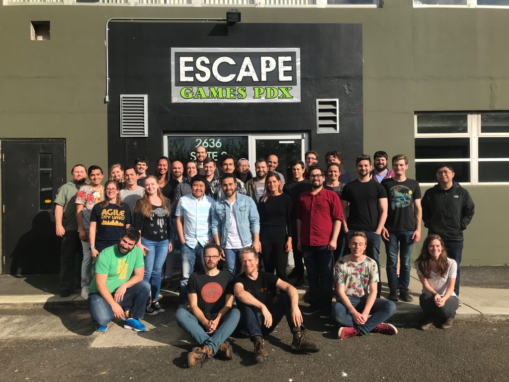 Group photo of PLUS QA employees in front of Escape Games PDX