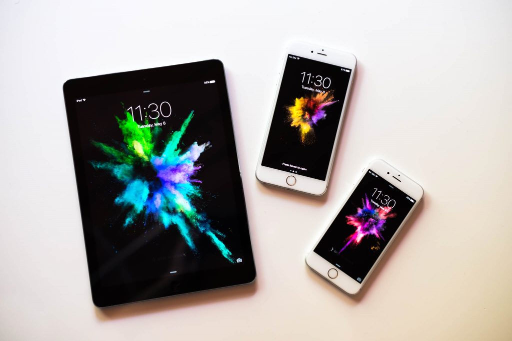 Photo of one iPad and two iPhones