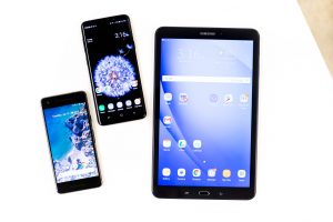 Three Android devices on a white background