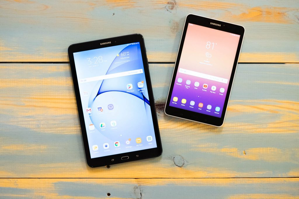 Overhead shot of an Android tablet and phone on a table