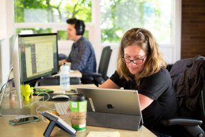 Photo of QA testers Kari Ponto working at her desk