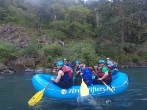 Some members of PLUS QA team in a raft on White Salmon River