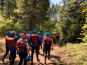 PLUS QA team walking toward the rapids