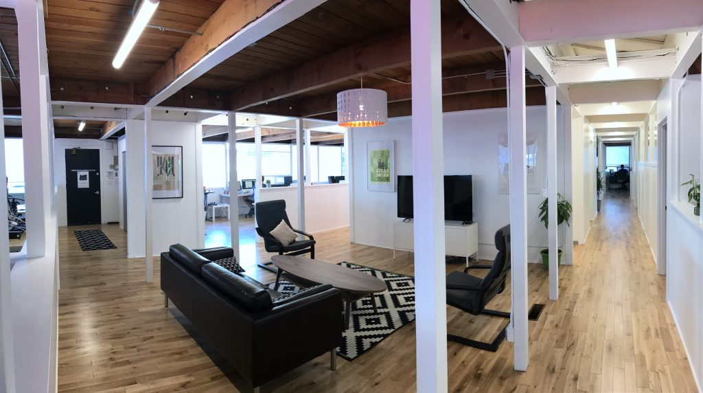 Photo of PLUS QA open concept office space