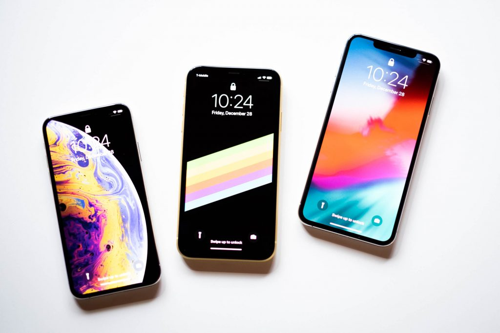 Three iPhone Devices on White Background