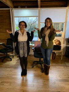 Two women employees from PLUS QA striking the #BalanceForBetter pose
