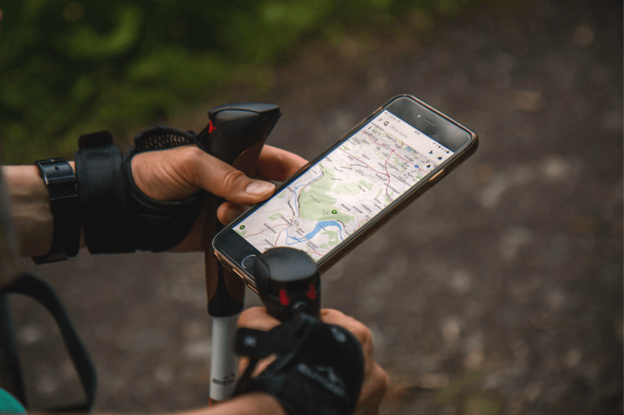 User engaging with app on their phone while hiking