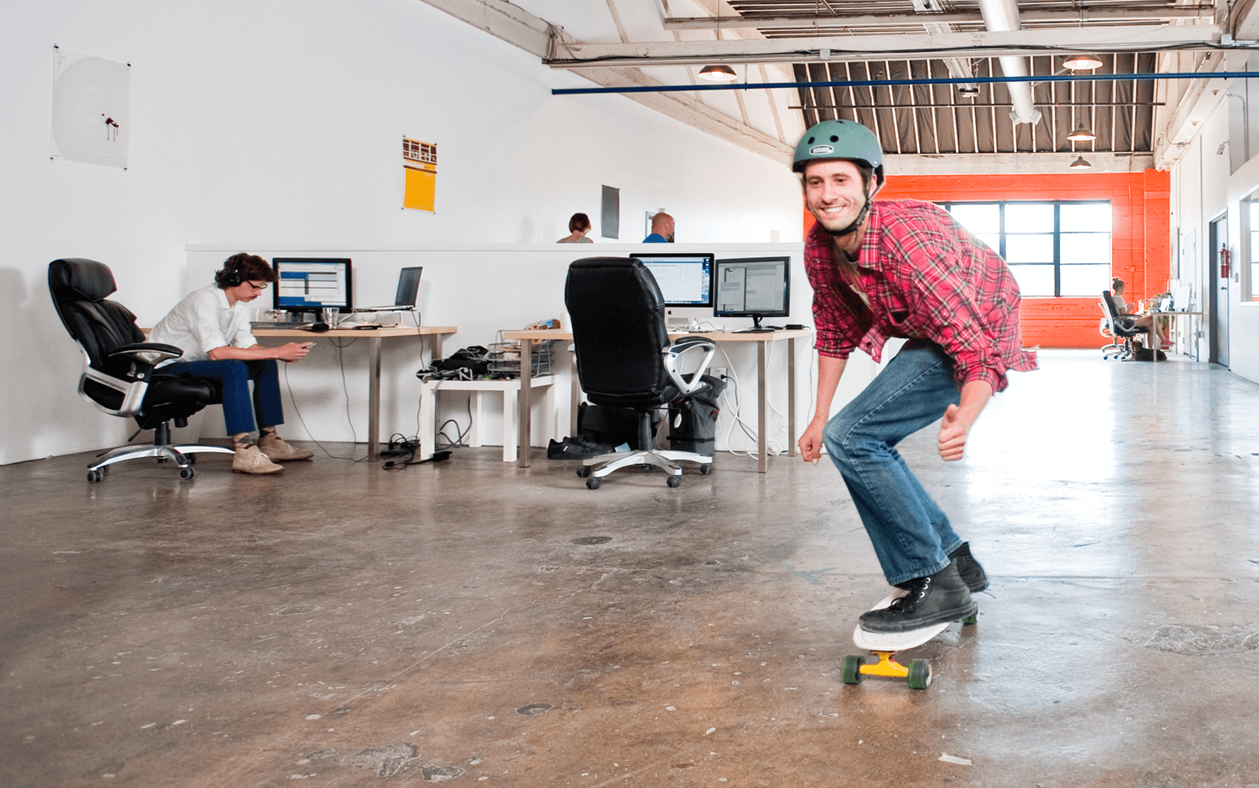 Employee riding a skateboard in the office