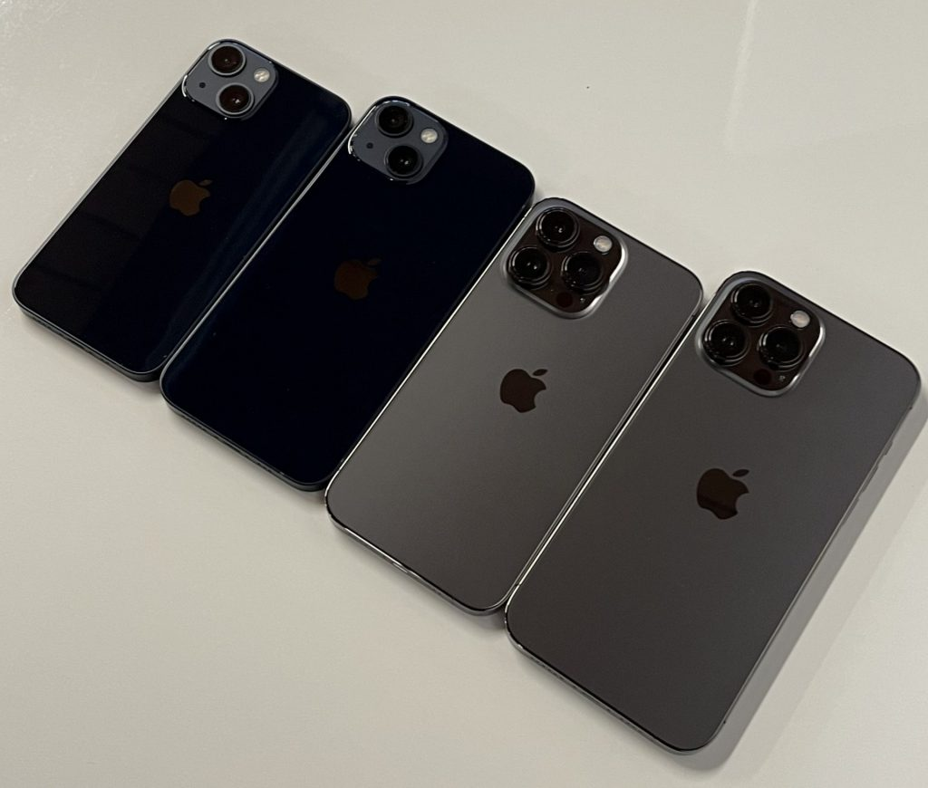 The iPhone 13 series side by side, facedown on a desk